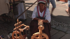 Woman with the reel - Mittenwald, Germany - Bozner Markt 2012 Stock Footage