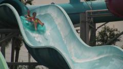 People Going Down Waterslide with Tube Stock Footage