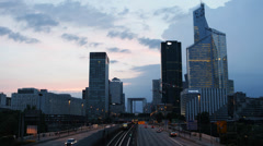 Dusk View of La Defense Paris Business District Car Traffic Busy City Commuters - stock footage