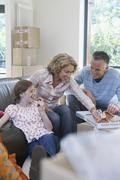 Family Eating Pizza In New Home - stock photo