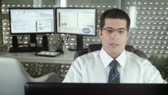 Young business man in a video conference Stock Footage