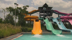 Colored Tube Water Slides in Action at Orlando Waterpark Stock Footage