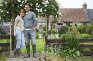 Stock Photo of Couple Outside Country House