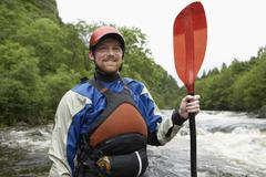 Man With Kayak Oar Against River Stock Photos