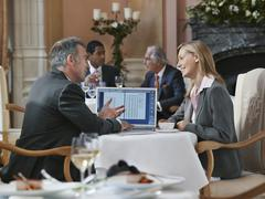 Businesspeople Having Conversation With Laptop Stock Photos