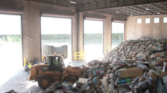 A Front End Loader Moves Trash at a Recycle Center ( 7 of 9) - stock footage
