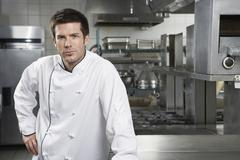 Confident Chef In Kitchen - stock photo