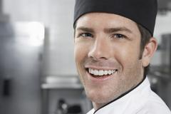 Smiling Male Chef In Kitchen Stock Photos