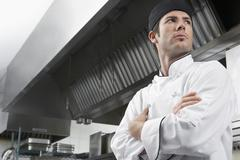 Chef With Arms Crossed In Kitchen - stock photo