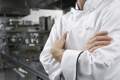 Midsection Of Chef With Arms Crossed Stock Photos
