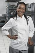 Female Chef In The Kitchen Stock Photos