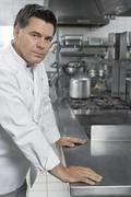 Portrait Of Male Chef In Kitchen Stock Photos