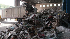 A Truck Dumps Trash to be Recycled (7 of 10) Stock Footage