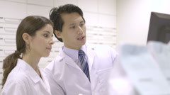 MS TU Male and female Pharmacist working in pharmacy - stock footage