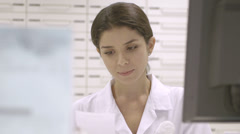 Stock Video Footage of CU pharmacist working in pharmacy