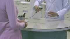 MS TU Pharmacist scanning bar code through bar code reader Stock Footage