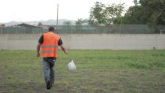 Young worker losing her job. He leaves construction site Stock Footage