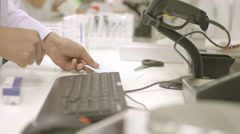 Pharmacist working in pharmacy - stock footage