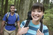 Stock Photo of Smiling Couple With Backpacks