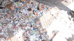 A Front End Loader Moves Trash at a Recycle Center ( 3 of 9) - stock footage