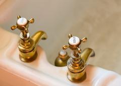 Antique bath taps or faucets Stock Photos