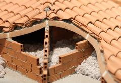 Attic insulation with the insulating material of the house made of brick red Stock Photos