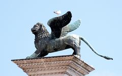Statue of winged lion, symbol of the serenissima republic of venice in northe Stock Photos
