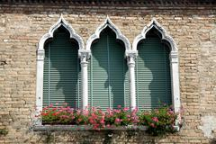 luxurious flowery balcony in venetian style with arched windows - stock photo