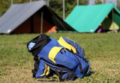 backpack in the campsite - stock photo