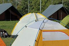 igloo tents and canadian  tent camping in a scout camp - stock photo