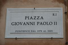 Road sign with an indication of the piazza giovanni paolo ii pope in rome ita Stock Photos