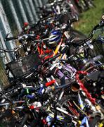 saddles and handlebars of bicycles of students - stock photo