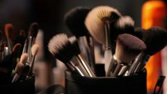 Brush set for make-up on table (dolly shot) - stock footage