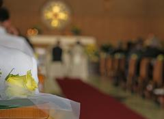 Christian church during the rite of marriage with a yellow rose and the bride Stock Photos