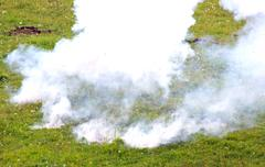 Guerrilla with an explosion with a thick blanket of smoke 3 Stock Photos