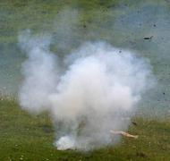 Guerrilla with an explosion with a thick blanket of white smoke 2 Stock Photos