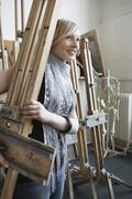 Art Student Carrying Easel In Studio Stock Photos