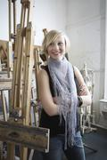 Female Student Amid Easels In Art College Stock Photos
