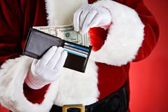 Santa: pulling cash out of wallet Stock Photos