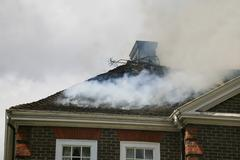 Stock Photo of House roof on fire