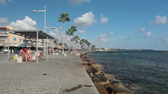 People walking in Paphos embankment, Cyprus Stock Footage