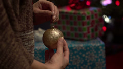 Hanging an ornament - Slow Motion Stock Footage