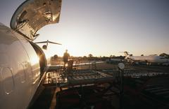 Stock Photo of Loading freight onto Boeing 727 jet aircraft
