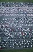 Cars and trucks parked in carpark view from above - stock photo
