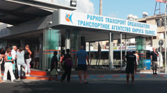 Paphos main bus station building with passengers getting on the car Stock Footage