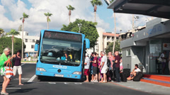 People boarding the bus in Kato station in Paphos, Cyprus Stock Footage