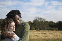 Contended Couple Embracing In Field - stock photo