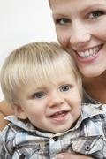 Smiling Mother Holding Son Stock Photos