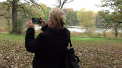 Elegant woman takes pictures on the smartphone Stock Footage