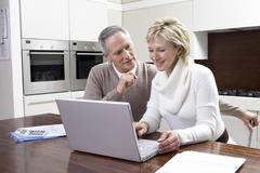 Stock Photo of Couple Calculating Home Finances On Laptop